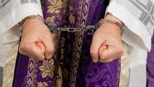 Handcuffs-on-priest-via-Shutterstock-800x430