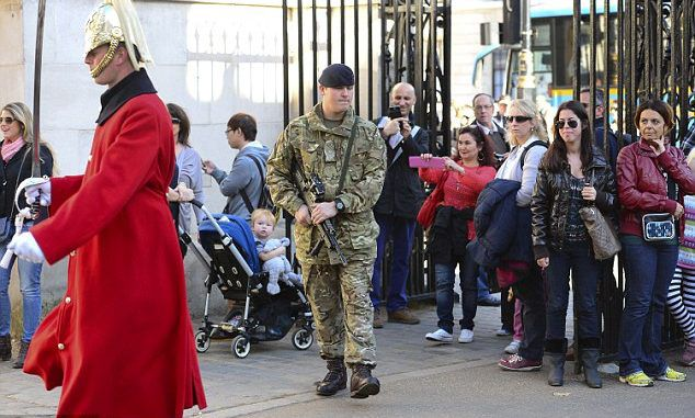 Armed guards seen on the streets of Westminster as military boosts security in the wake of Canadian parliament attack