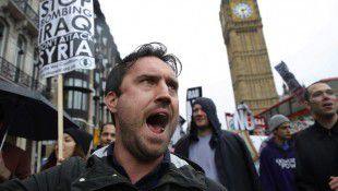 Demonstrators march through London to protest British air strikes against Islamic State in Iraq