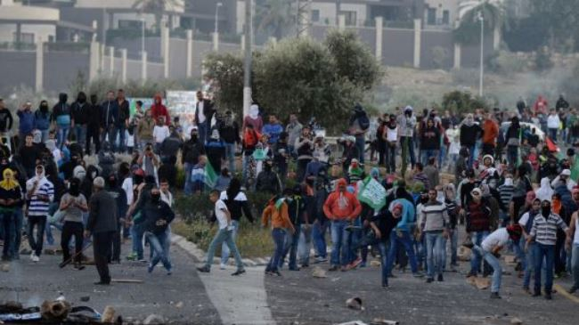 Palestinian, Israeli forces clash after young Palestinian's death