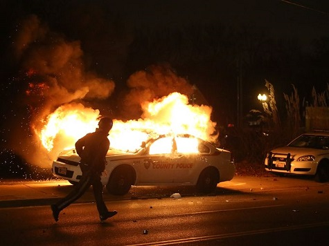 Gunshots heard and buildings set ablaze as grand jury decides not to indict officer over Michael Brown shooting