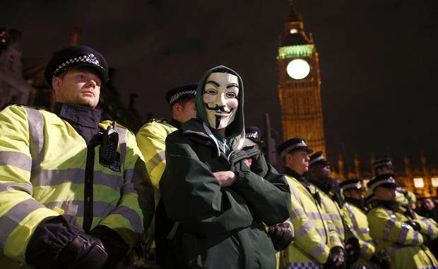 Riot police on alert for bonfire night 'Million Mask March' by activists Anonymous