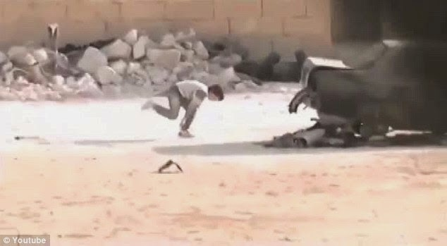 Footage of Syrian 'hero boy' dodging bullets to save girl revealed as FAKE