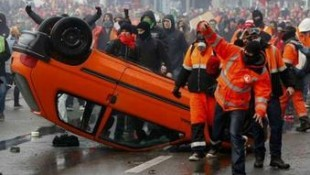 Police deploy water cannon and tear gasas 100,000 march in Brussels against austerity