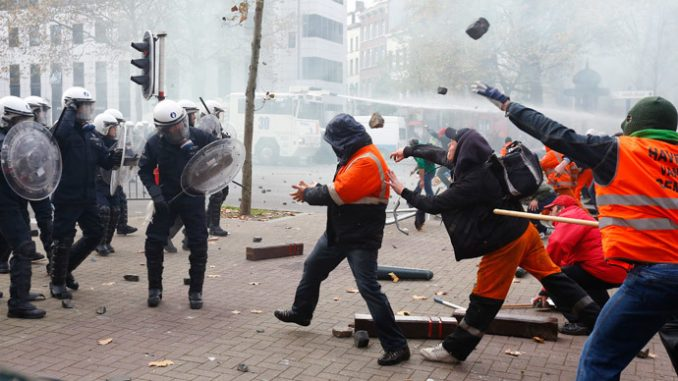 Police deploy water cannon and tear gas as 100,000 march in Brussels against austerity