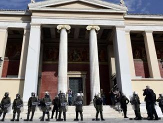 Greek riot police and protesters clash in Athens