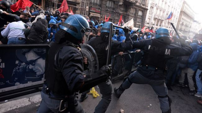 Police and anti-government protesters clash in Italy