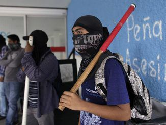 Mexican protesters set fire to regional party HQ over 43 missing students