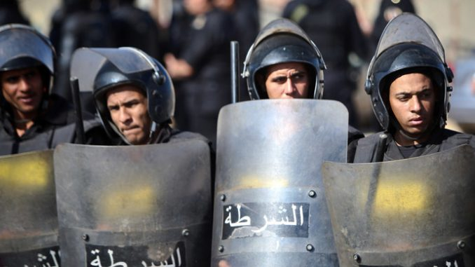 Police fire tear gas as Mubarak verdict brings protests to Tahir Square in Cairo
