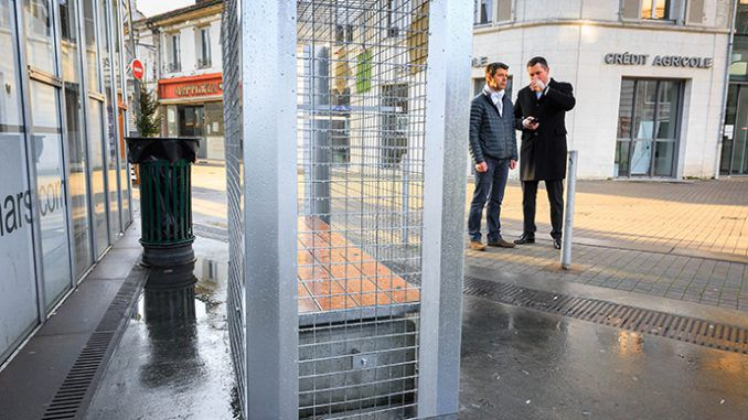 Anti-homeless cages installed around benches in French city on Christmas Eve