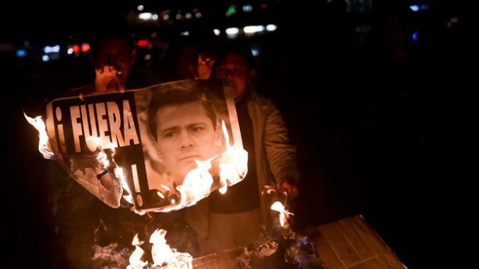 Mexicans march against president as fresh graves discovered