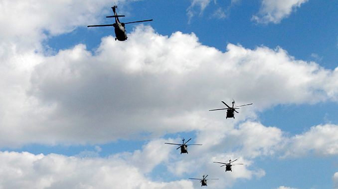 Black choppers rattle Dallas skyline in urban training drills