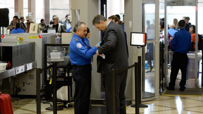 US steps up airport, federal building security after Paris attacks