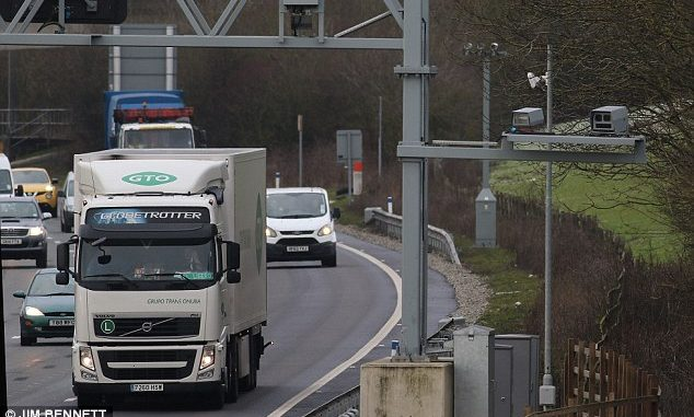 Company behind 'sneaky' new motorway speed cameras is paid £2.1million by the taxpayer so they can catch MORE drivers
