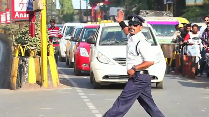 Is this MOONWALKING traffic cop in India the next Michael Jackson?