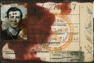 Oswald's-military-ID-said-to-have-been-stained-by-FBI-fingerprinting-fluid.-300x203