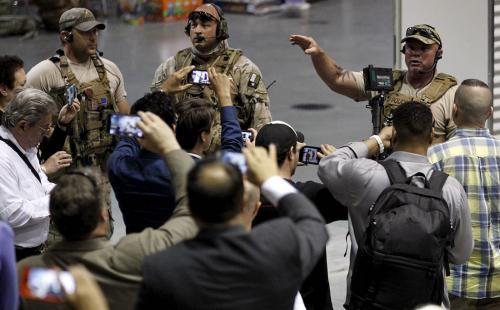Police officers address attendees at the Muhammad Art Exhibit and Contest after they are prevented from leaving when it was reported that shots were fired and a man is down in Garland, Texas May 3, 2015.