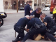 Video of nine LA cops slamming unnarmed black teenager to ground for 'jaywalking'