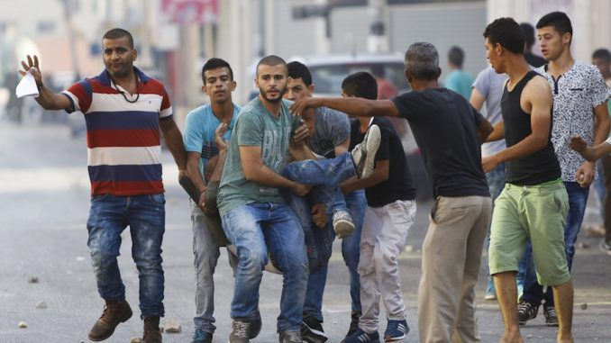 A Palestinian teen is killed by Israeli soldiers amid clashes