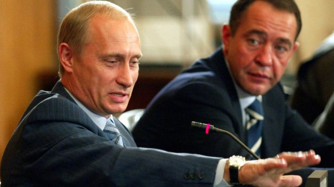 An associate of Russian President Vladimir Putin, Mikhail Lesin (pictured right), has been found dead in a hotel under suspicious circumstances