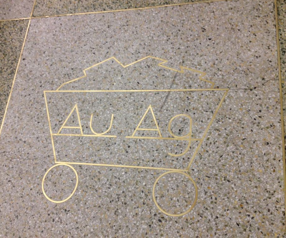Denver International Airport AU AG symbol on the ground