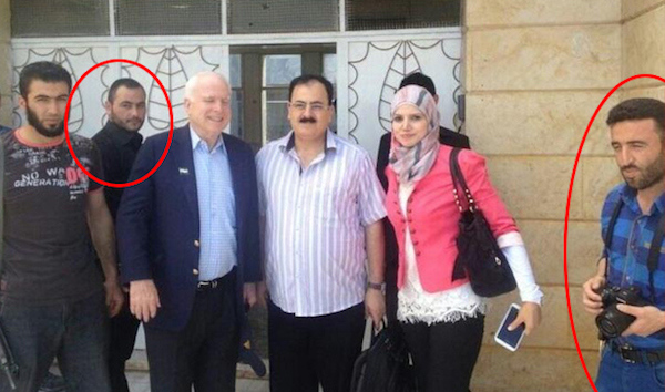 Senator John McCain with ISIS Chief Abu Bakr Al-Baghdadi (circled left) and terrorist Muahmmad Noor (circled right).