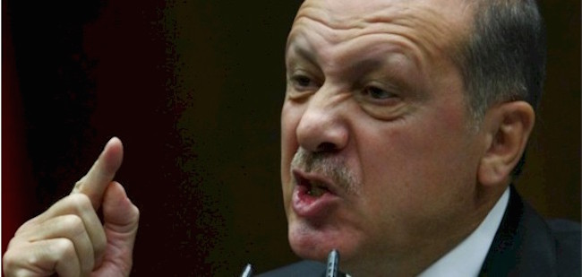 Turkish President Erdogan silences a journalist during a press conference when asked about Turkey's support of ISIS