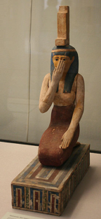Fig. 15 Ancient Egyptian statue of Isis on her knees