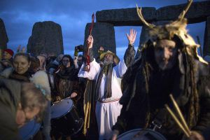 Revellers celebrate the winter solstice at Stonehenge on Salisbury Plain in southern England