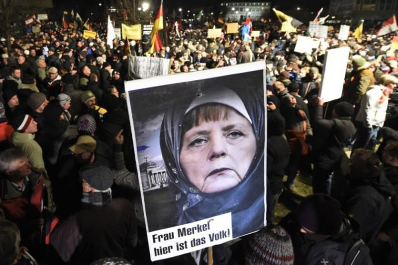 Hundreds of Germans call for Angela Merkel to be prosecuted for treason