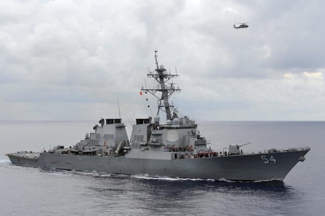 China accuses the U.S. government of breaking the law as one of their warships passes by the South Sea China islands