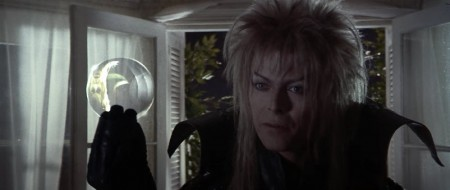 """Jareth offering Sarah """"gifts"""" represented by the crystal ball"""
