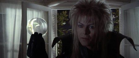 "Jareth offering Sarah ""gifts"" represented by the crystal ball"