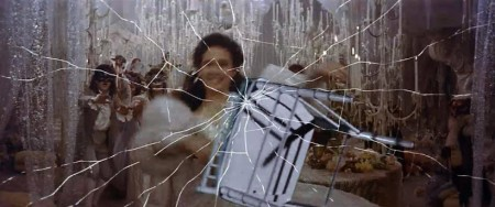 To escape the ball, Sarah must shatter a mirror – a symbolic image representing the fracture of her personality.