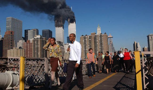 Briton who is the brother of a 9/11 victim has demanded that the inquiry into what happened during the September 11 attacks be re-opened