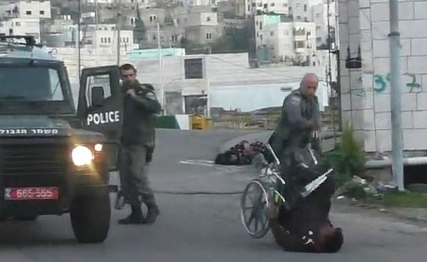 Israeli Police Officer Kicks Palestinian Man Out Of Wheelchair