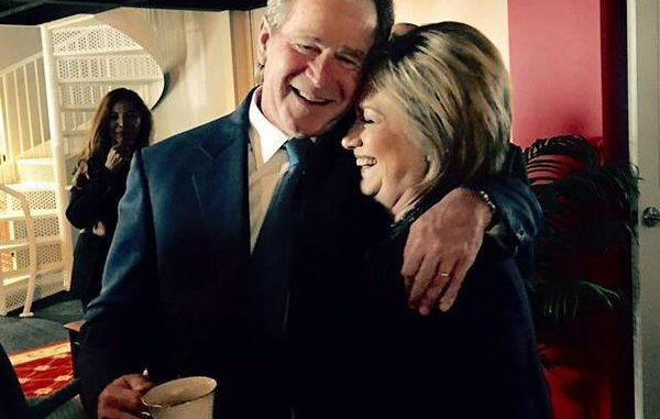 Theater of politics encapsulated in a photograph as Hillary Clinton and George W. Bush embrace at Nancy Reagan's funeral service