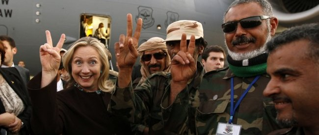 Hillary Clinton with Libyan soldiers in October 2011