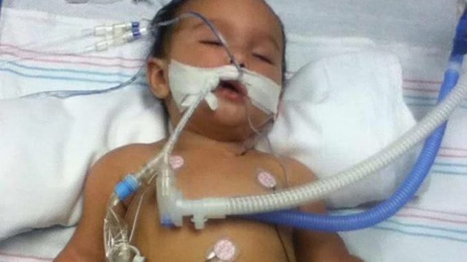 Six month old baby left brain damaged after receiving routine vaccinations