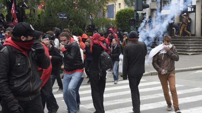 Riot Police Clash With Protesters In France