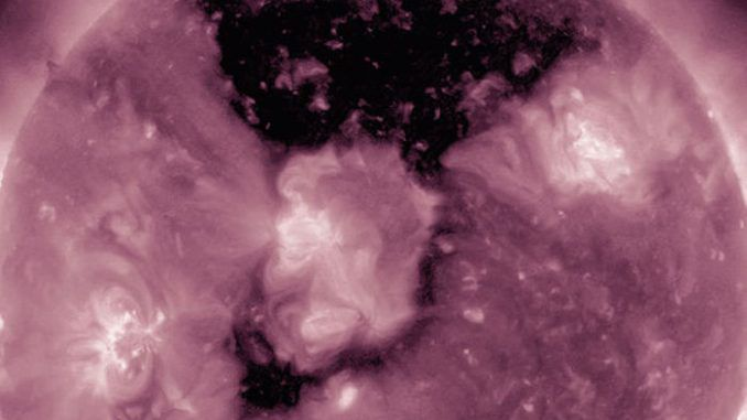 NASA reveals that a huge hole has appeared on the surface of the Sun which appears to be swallowing the giant star up