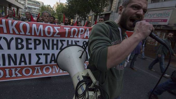 Thousands Protest As Greek Parliament Adopts New Austerity Measures