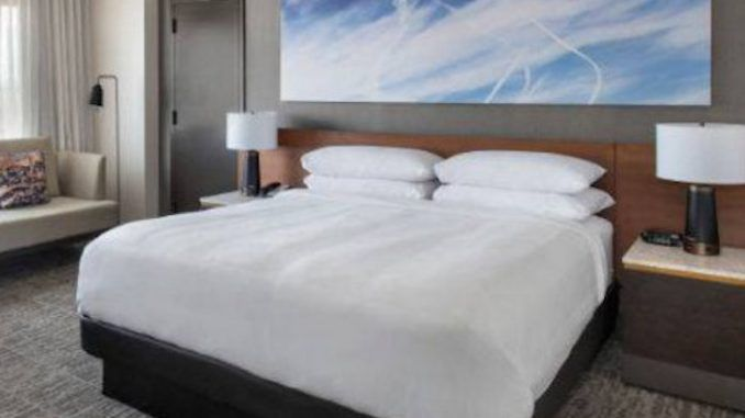 High-end hotel chain JW Marriott has been accused of attempting to normalize the chemtrail agenda by placing artworks on their walls featuring chemtrails sprayed on blue skies.
