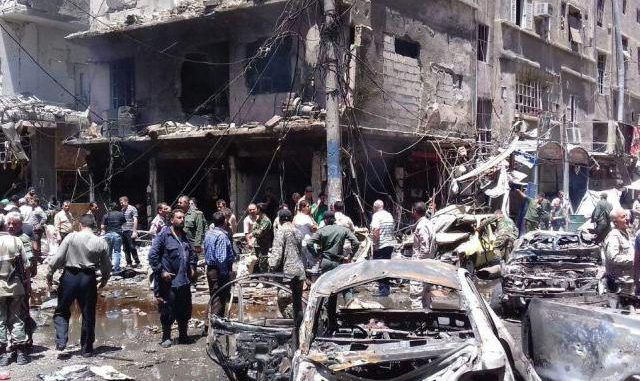 At Least 20 Dead As Twin Blasts Hit Town Near Damascus