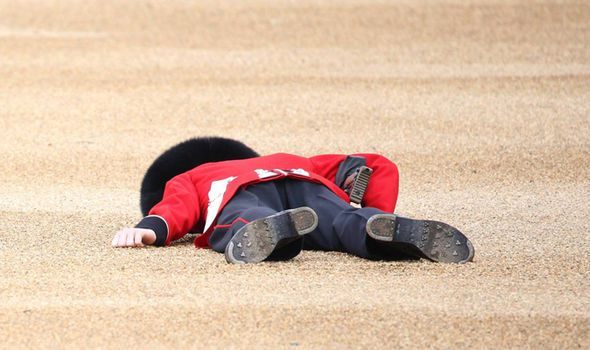 Royal Guardsman Collapses At Queens Trooping Of The Colour Parade