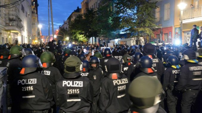 Revolution spreads to Germany as riot police deployed