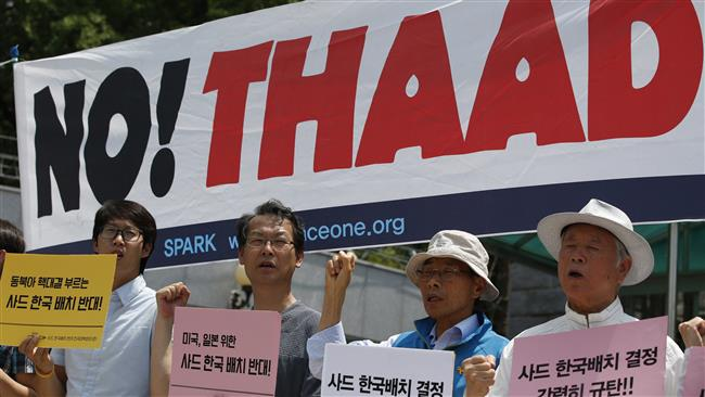South Korean protesters shout slogans during a rally to denounce deploying the US THAAD missile defense system in Seoul on July 8, 2016. ©AP