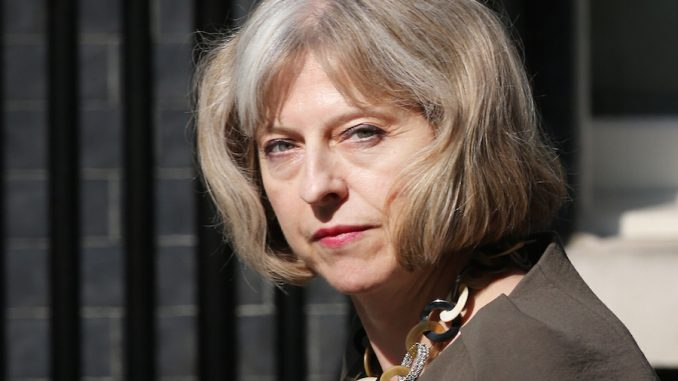 British Prime Minister Theresa May says paedophiles should be allowed to adopt