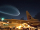 Airports workers in Miami were left stunned when a giant UFO floated above them, lighting up the night sky.