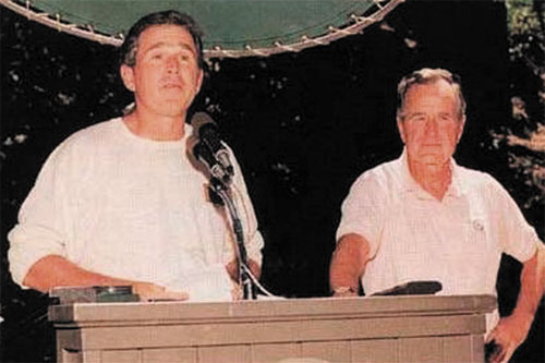 Former President George W. Bush and his father attending Bohemian Grove